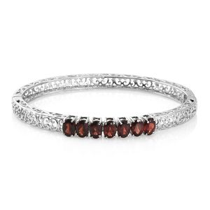 Mozambique Garnet Stainless Steel Openwork 7 Stone Bangle (7.25 in) TGW 5.94 cts.